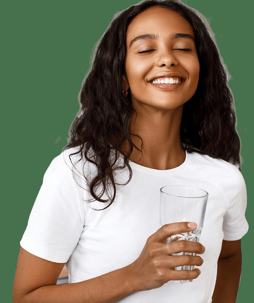 beautiful woman drinking a fresh glass of water